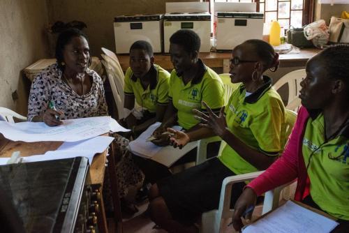 Members sharing ideas in a group headed by Klinnie Bazipye.